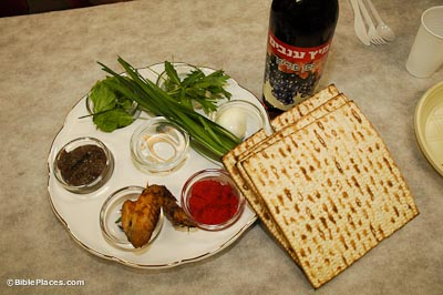 Passover seder plate with matza and wine