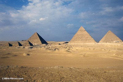 Three Giza pyramids with smaller ones in front