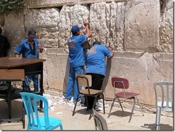 Western Wall men cleaning out prayers, tb090402207