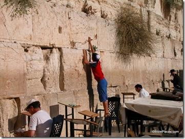 Man putting prayer in Western Wall, tb092603035