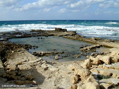 The rocky shore of the Mediterranean Sea, a rectangular shape is indented and has some water in it